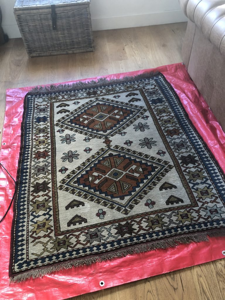 Stained Oriental Rug